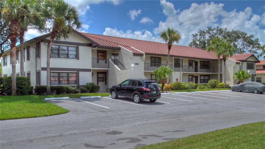 5630 Golf Pointe Drive #205, Sarasota FL 34243 - Photo 1